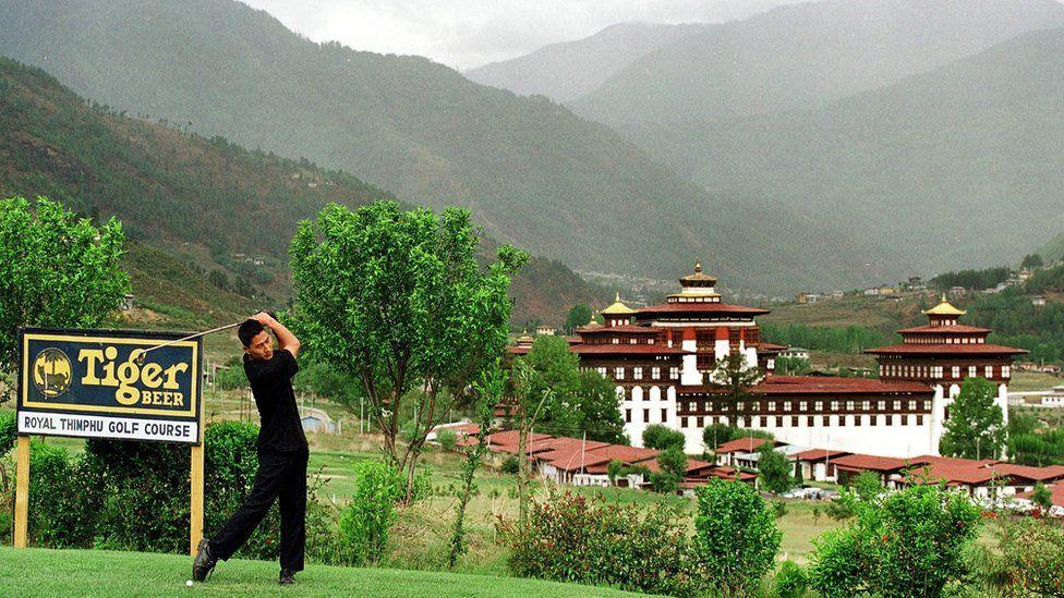 Man plays golf in Bhutan