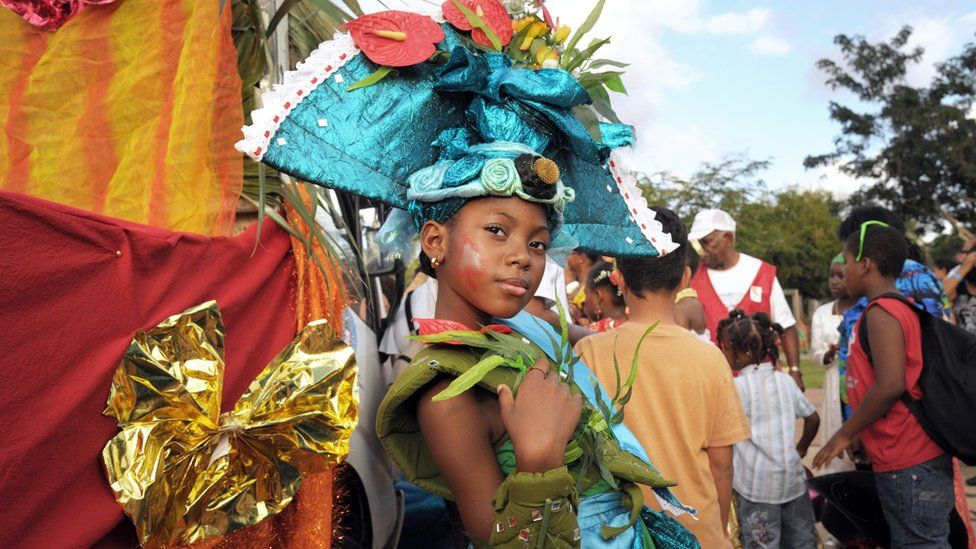 """'Mini queen of Martinique"""" poses during carnival parade in Fort-de-France"""