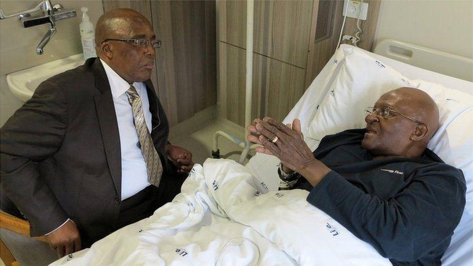 South Africa's Archbishop Desmond Tutu (R) and Health Minister Aaron Motsoaledi