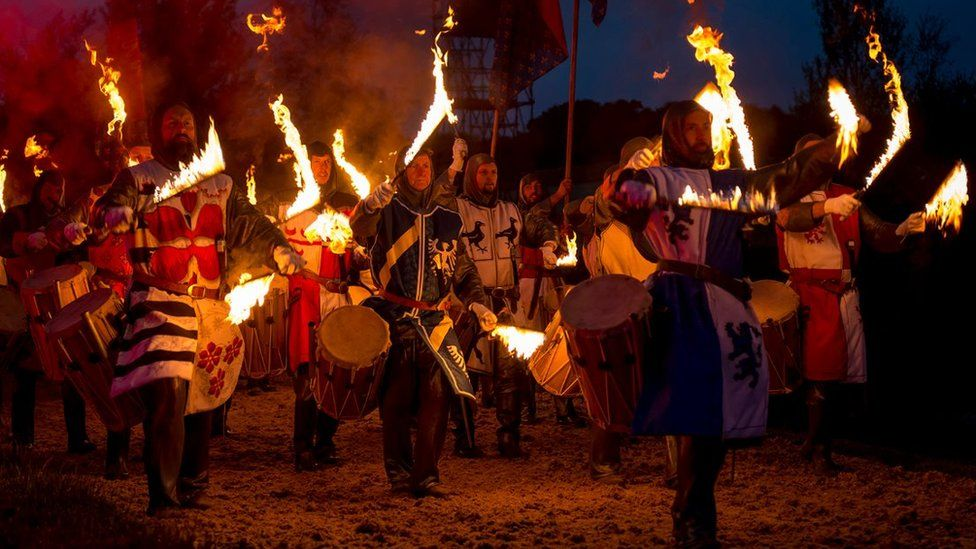 Drummers with flaming drum sticks