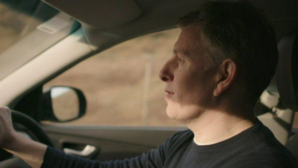 Patrick Kielty driving