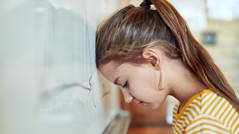 A young girl in a classroom
