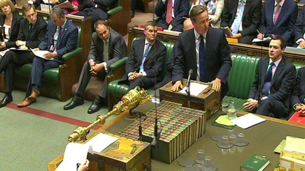 David Cameron standing at the dispatch box in the Commons
