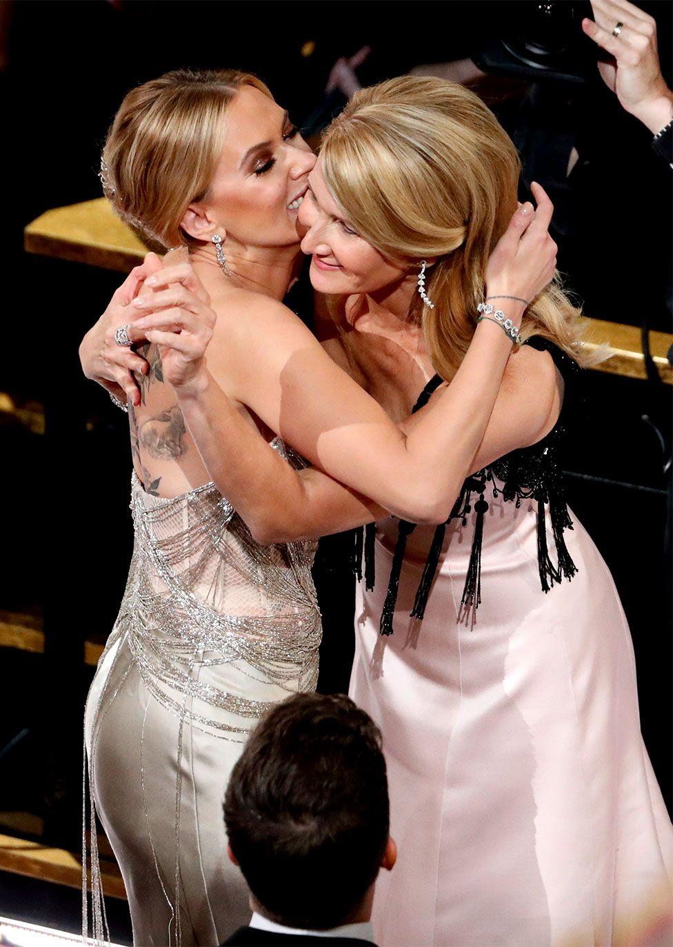 Scarlett Johansson gives Laura Dern a congratulatory hug