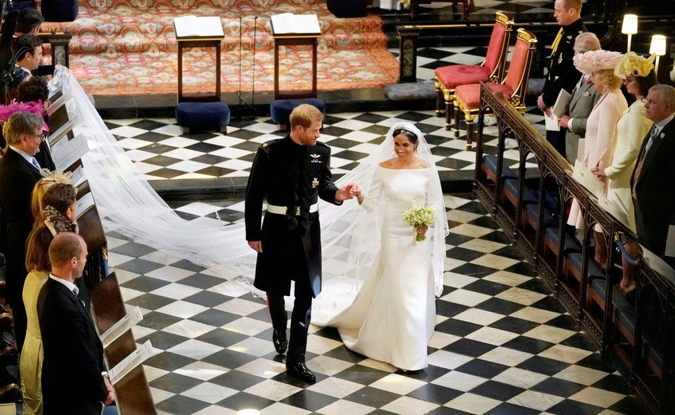 Prince Harry and Meghan Markle depart from St George's Chapel in Windsor Castle after their wedding
