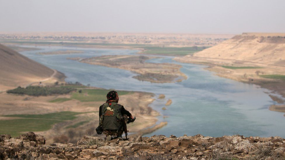 A Syrian Democratic Forces (SDF) fighter rests while looking over the Euphrates River, north of Raqqa city, Syria 8 March 2017