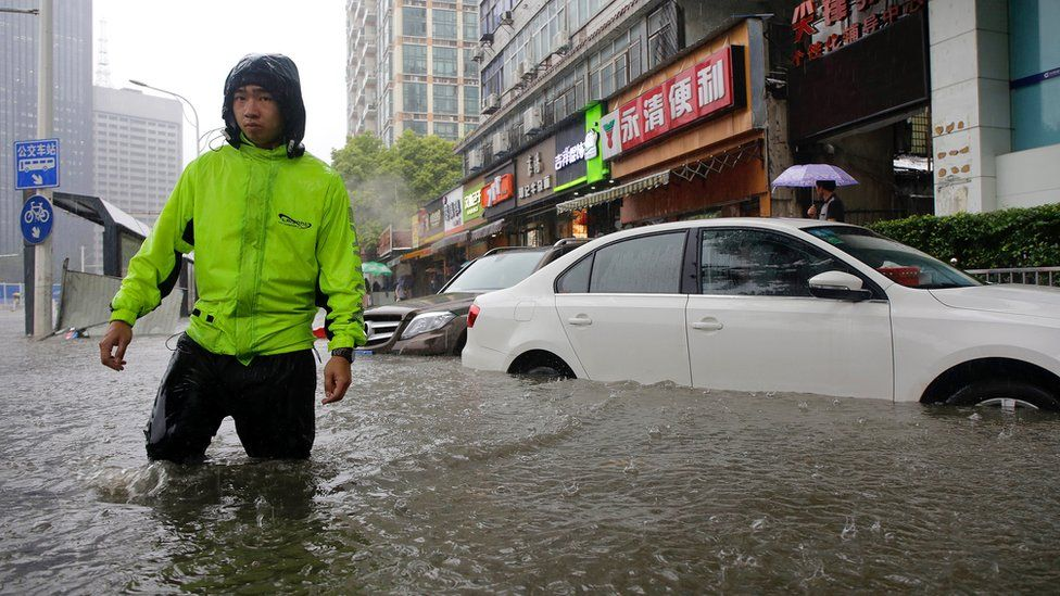 A man wades through water up to his knees