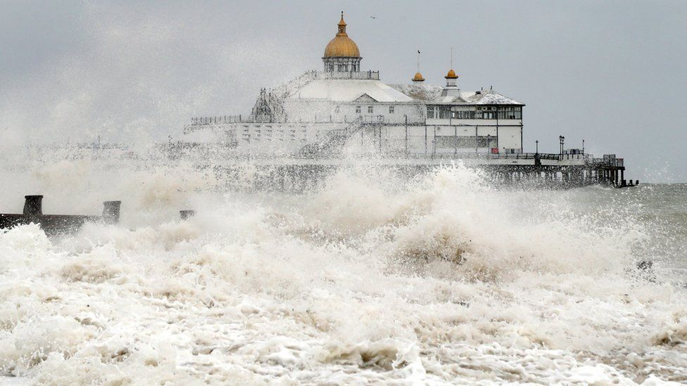 Waves crash near the pier in Eastbourne, East Sussex, as winds of up to 70mph are expected along the coast during the next 36 hours along with up to 90mm of rain as Storm Francis hit the UK.