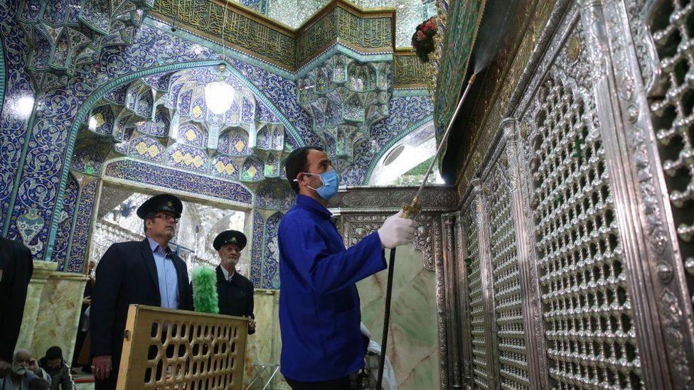 Iranian sanitary workers disinfect Qom's Masumeh shrine
