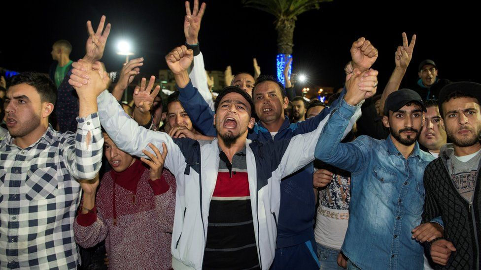 Protesters chanting in the street in the northern Moroccan city of Al-Hoceima after the death of a fishmonger - October 2016