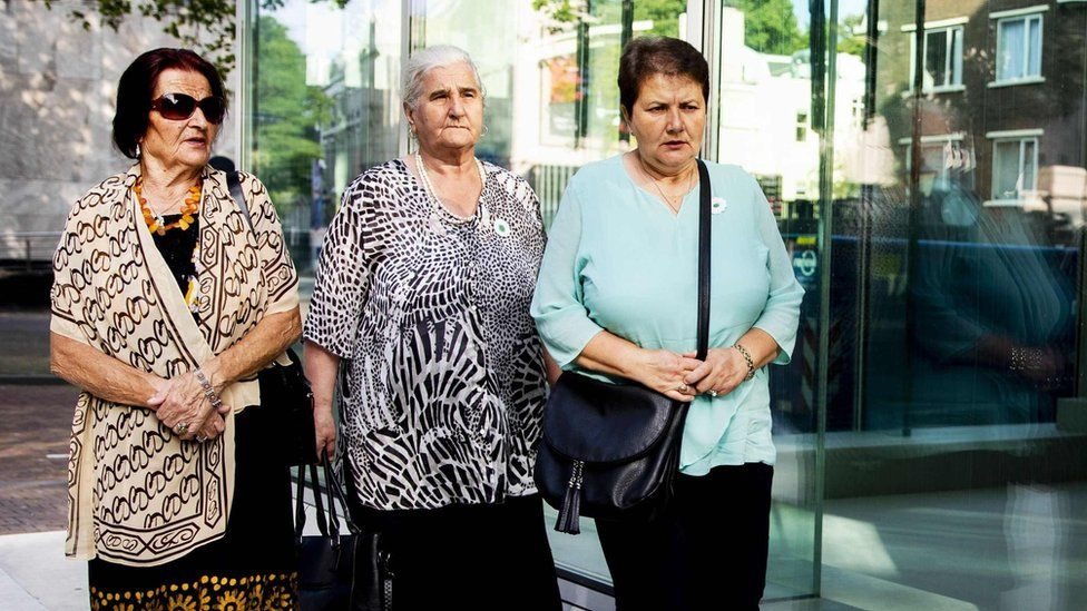 Three women from the group of victims' relatives, the Mothers of Srebrenica, arrive at the Dutch supreme court on 19 July 2019