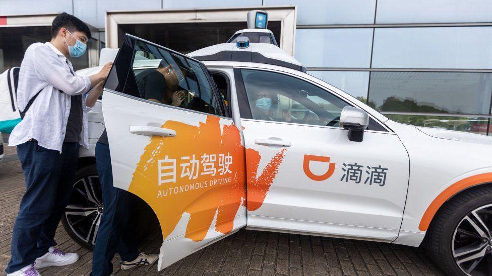 A passenger tries out DiDi autonomous driving robotaxi