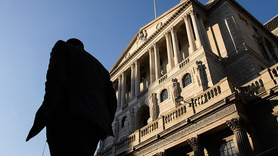 City worker walks in front of Bank of England