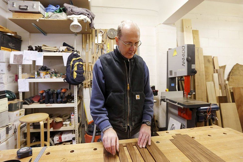 Canadian-born furniture-maker Michael Ibsen, a direct descendant of the eldest sister of King Richard III, works in his furniture workshop in London on October 8, 2012.