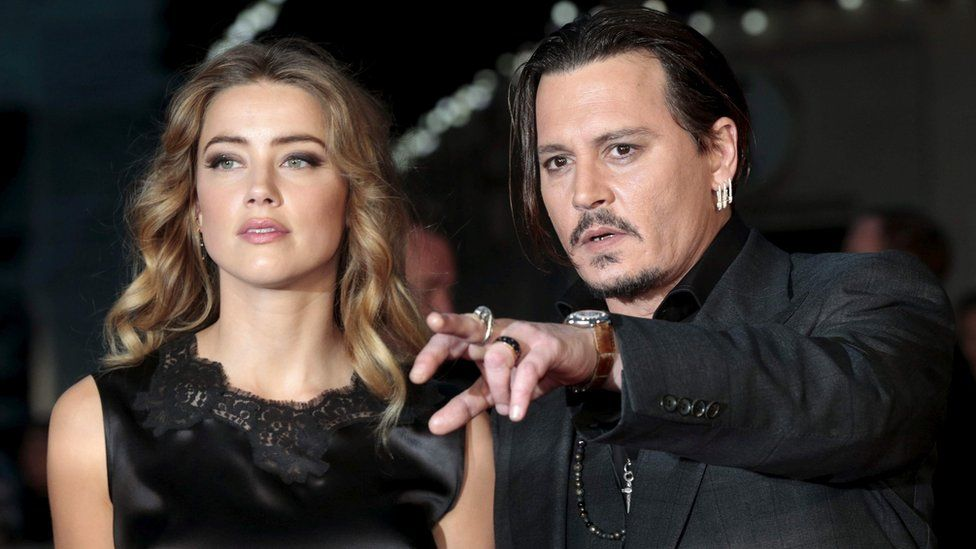 Amber Heard and Johnny Depp in London on 11 October 2015