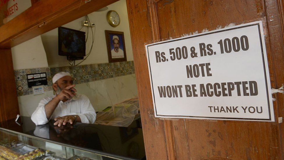 A shop owner in Mumbai displays a notice of non-acceptance of old Rs500 and Rs1000 currency notes