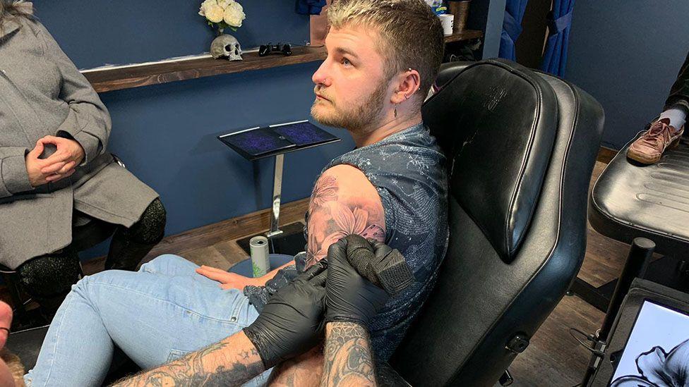 Jamie Rutter getting tattooed