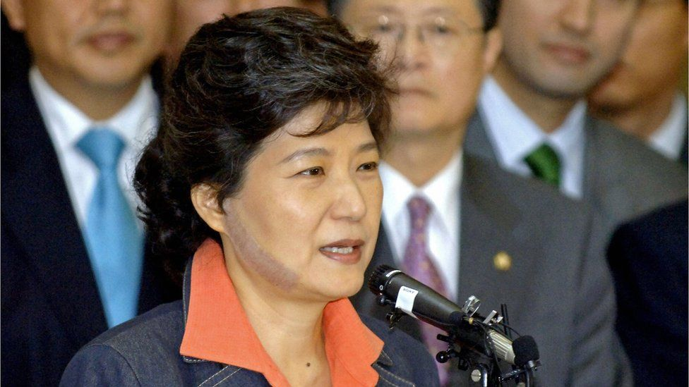 Park Geun-Hye speaks to supporters in Seoul on 29 May 2006, as she is discharged from hospital nine days after she was slashed in the face by an attacker. The image shows an 11cm scar on the right side of her face.