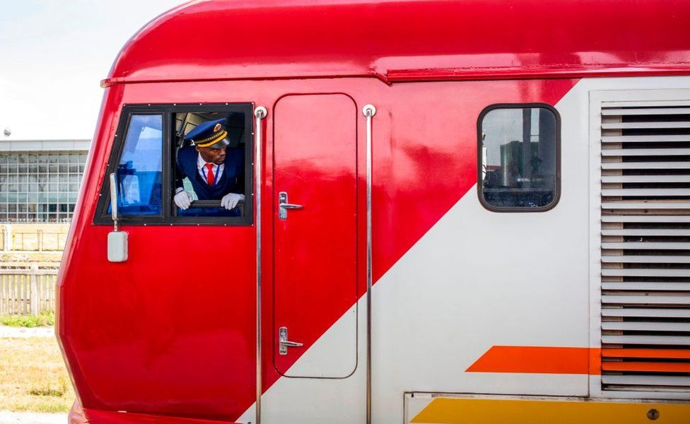 Train with a driver looking out of the window
