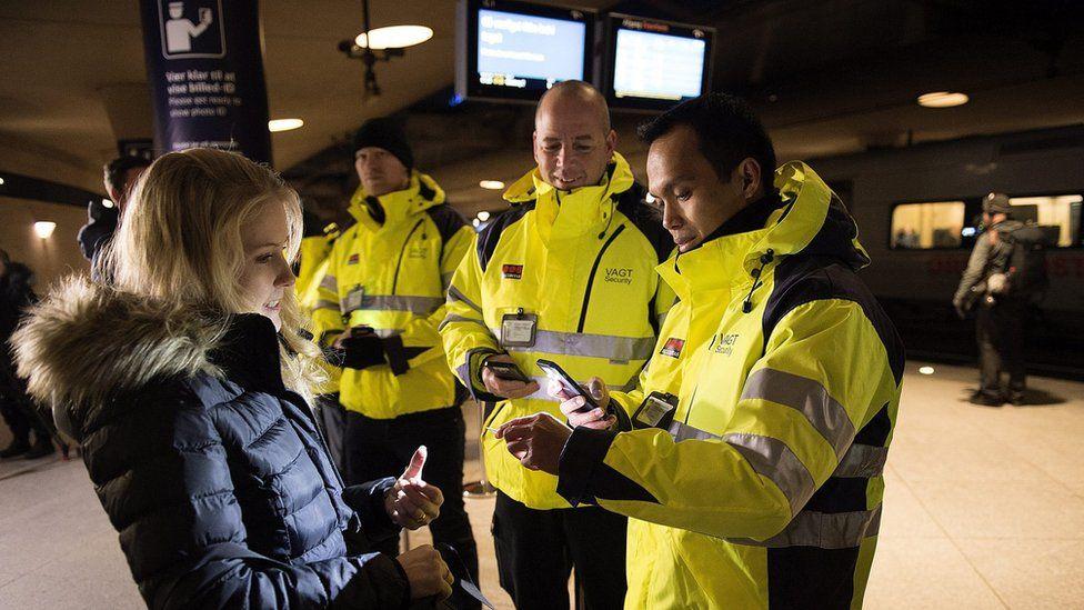 Security staff check IDs at Kastrup train station outside Copenhagen (4 Jan)