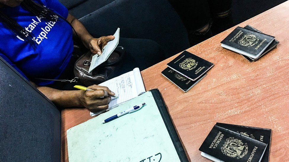 Passports lain out in front of authorities after the raids against human traffickers