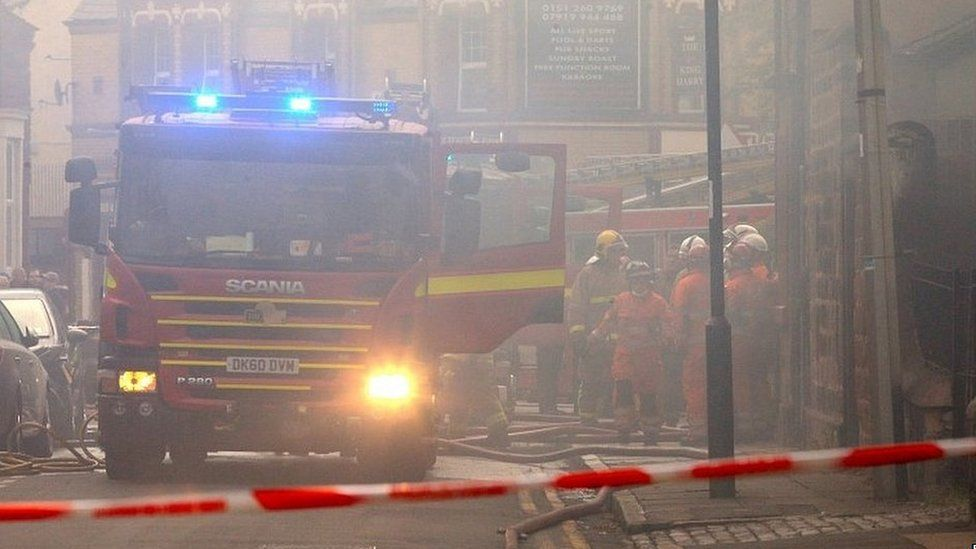 Firefighters at the scene of a fire in Liverpool