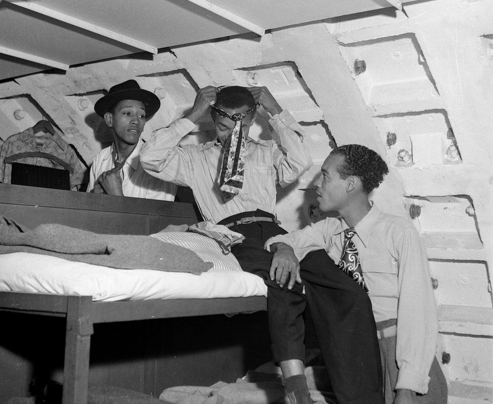 Immigrants Kenneth Murray, Eric Dryndale and Aston Robinson are seen in an ex-air raid shelter in 1948