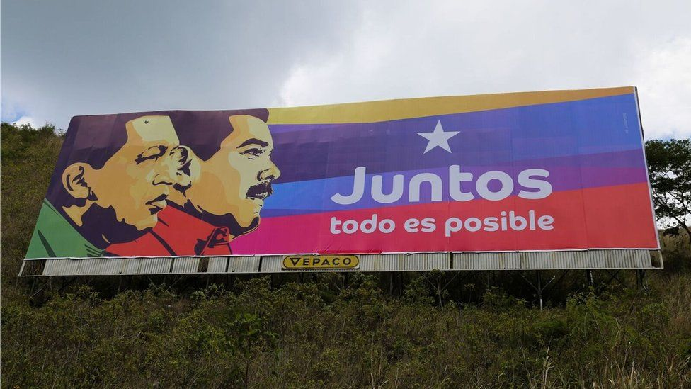 "A campaign poster showing President Maduro and his predecessor, Hugo Chávez, reads: ""Together everything is possible"""