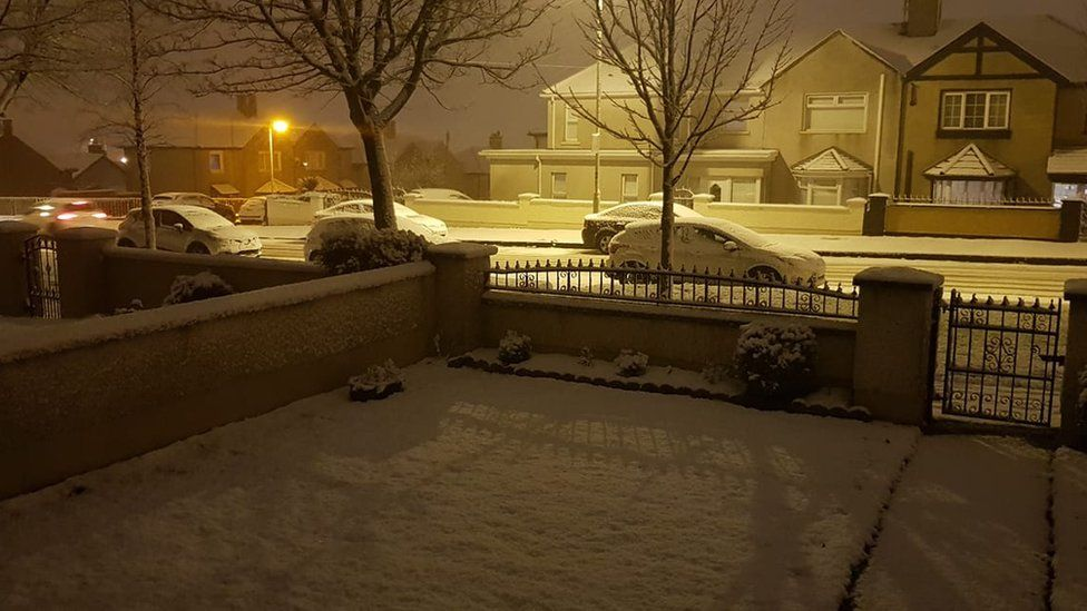 SNOW FALLS ON A HOUSING ESTATE IN DERRY