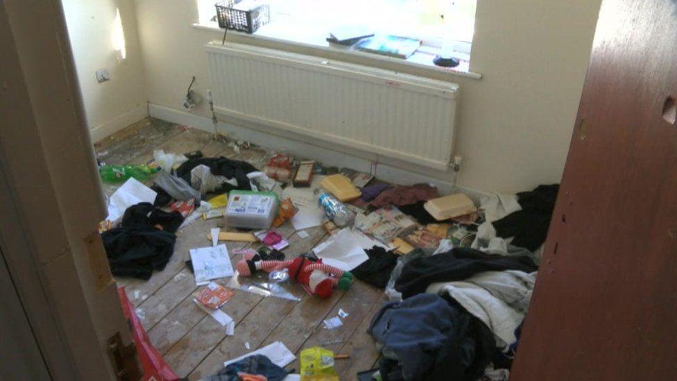 Room strewn with rubbish