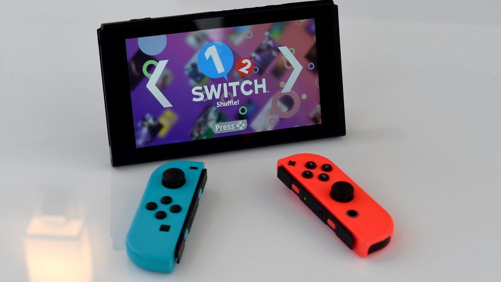 Nintendo Switch with Joy-con controllers removed, in portable mode, running 1-2 Switch game