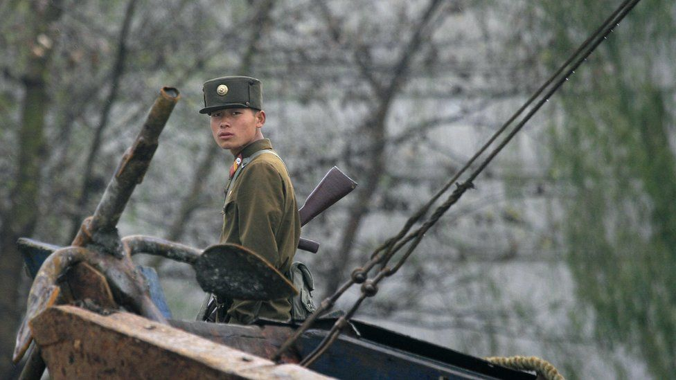 North Korean soldier beside the Yalu River, Sinuiju, near the border with China