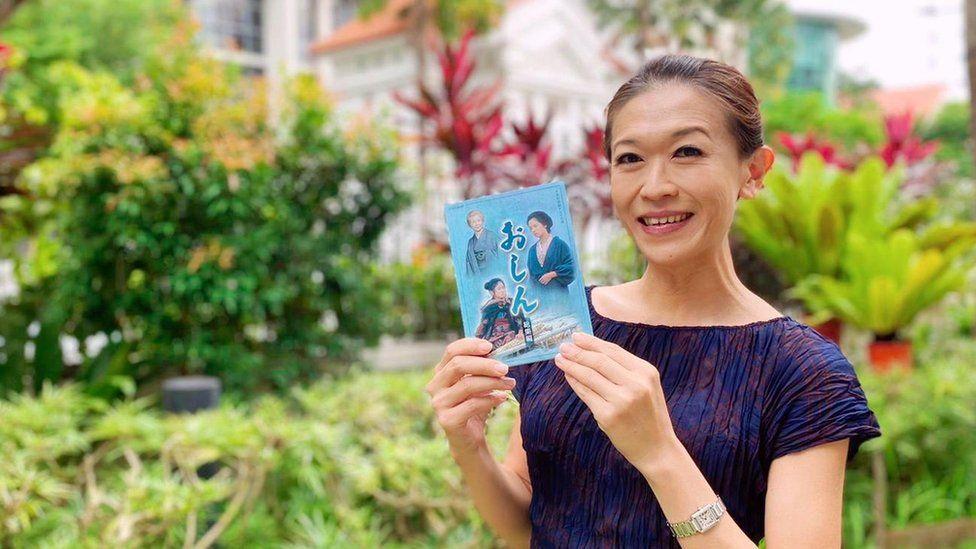 Singaporean TV fan Kit Ow holding Oshin DVD