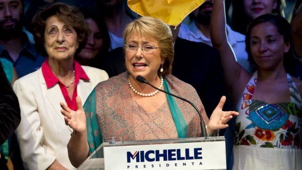 Michelle Bachelet, waves as she celebrates after getting the results of the run-off presidential election in Santiago on 15 December, 2013.