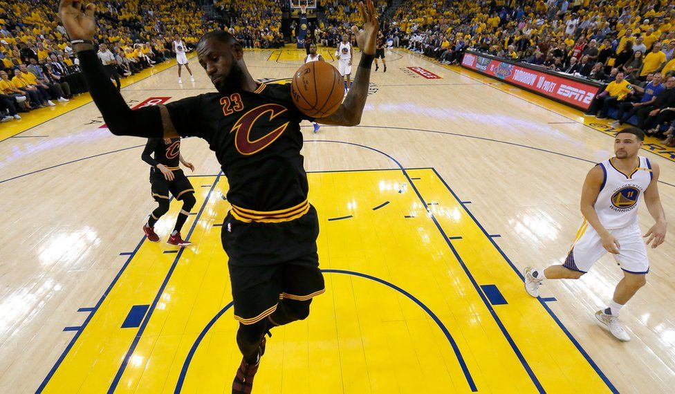 LeBron James, of the Cleveland Cavaliers, dunks the ball against the Golden State Warriors, June 2017