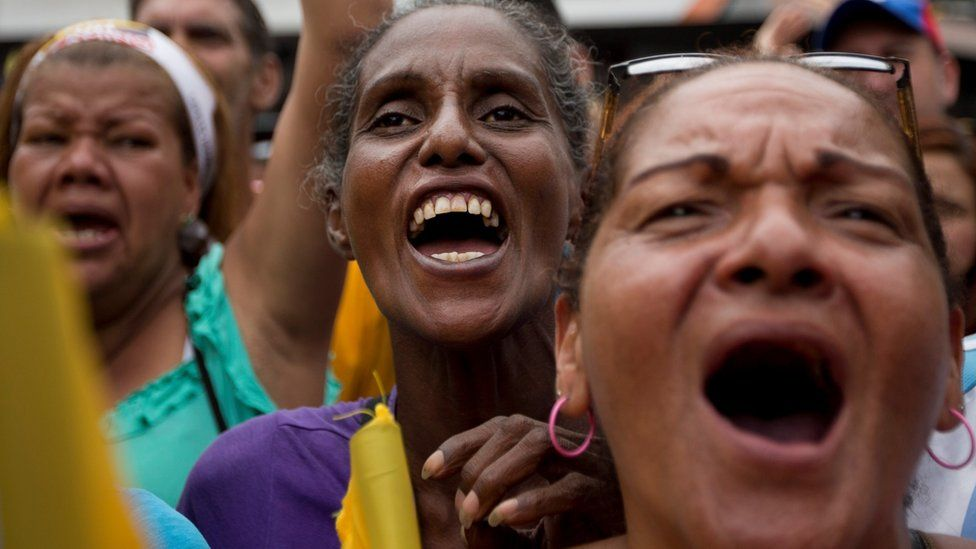 Demonstrators participate in a protest against the Venezuelan government in Caracas, Venezuela, 14 May 2016.