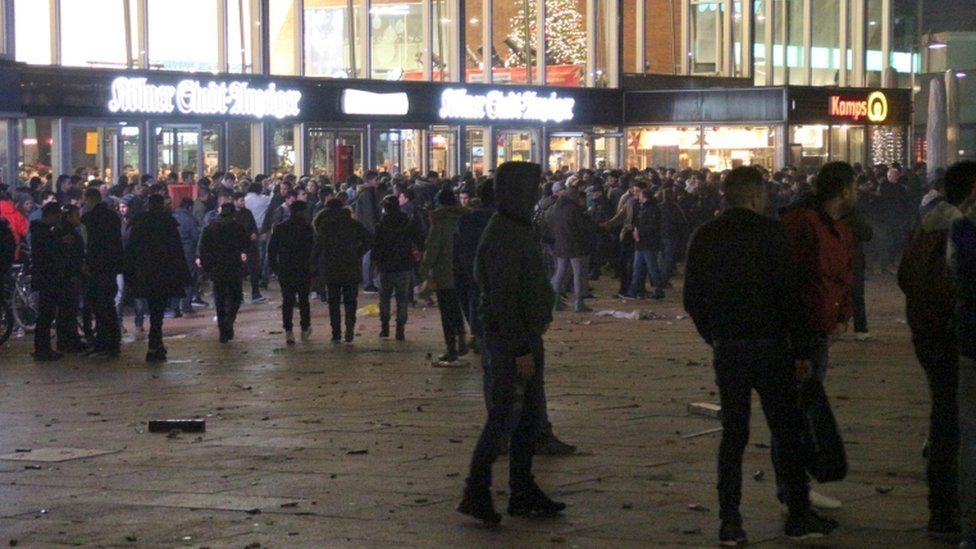 People gathering in front of the main railway station in Cologne, Germany, 31 December 2015