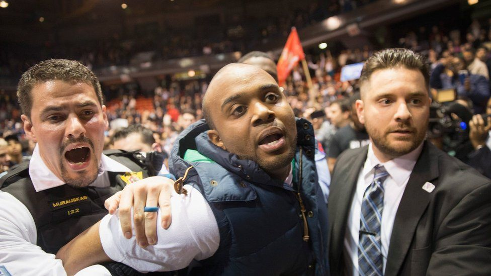 An activist is removed by police after it was announced that a rally with Republican presidential candidate Donald Trump at the University of Illinois at Chicago would be postponed on March 11, 2016 in Chicago, Illinois.