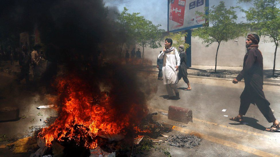 Afghan protesters set a fire during a protest in Kabul, Afghanistan 2 June 2017