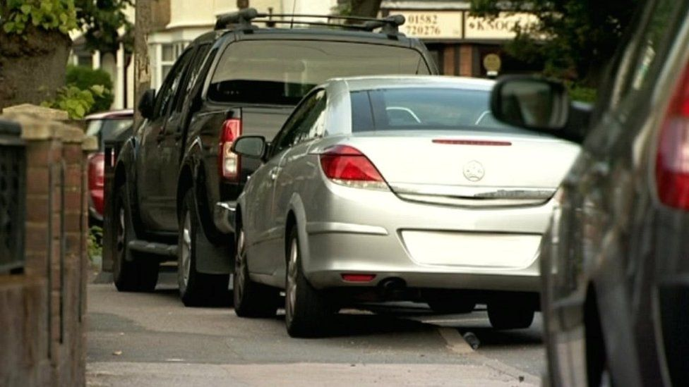 Parked cars on pavements