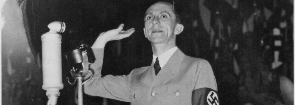 Joseph Goebbels with microphone and swastika armband