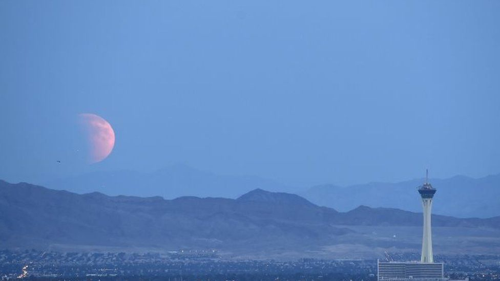 A partially eclipsed supermoon over the US city of Las Vegas