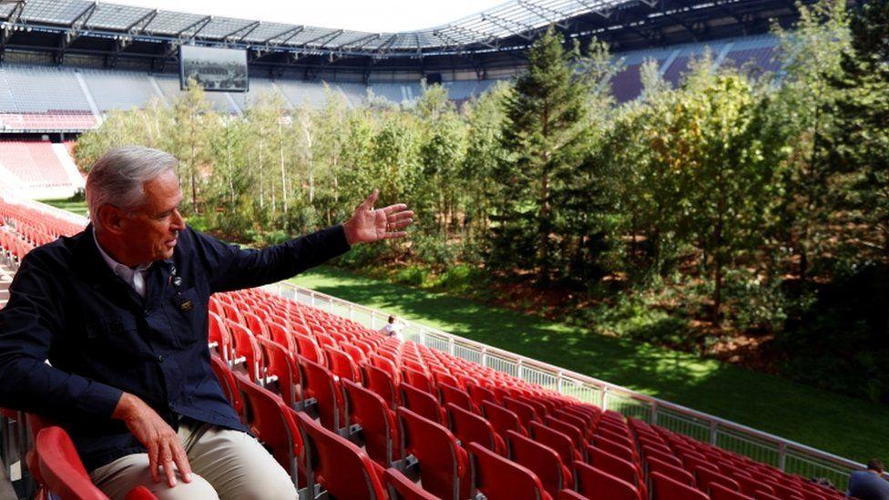 Artist Klaus Littman presents his art from the stadium seats