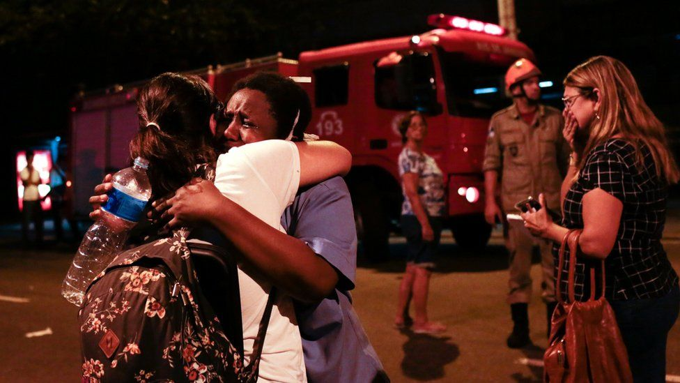 People react after a fire hit the Badim Hospital in Rio de Janeiro, Brazil September 12, 2019.