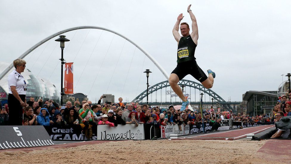 Greg Rutherford competing in the long jump event