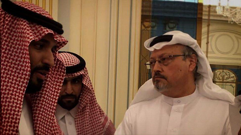 Jamal Khashoggi (right) with two unidentified people