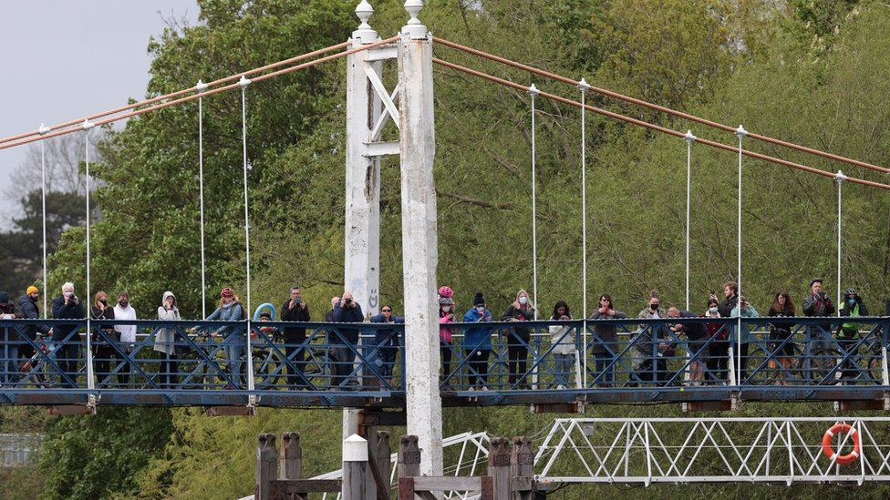 Onlookers crowded onto a bridge and the towpath at Teddington to look for the whale