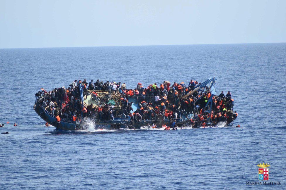 Migrants cling to a capsizing boat in the Mediterranean, 25 May
