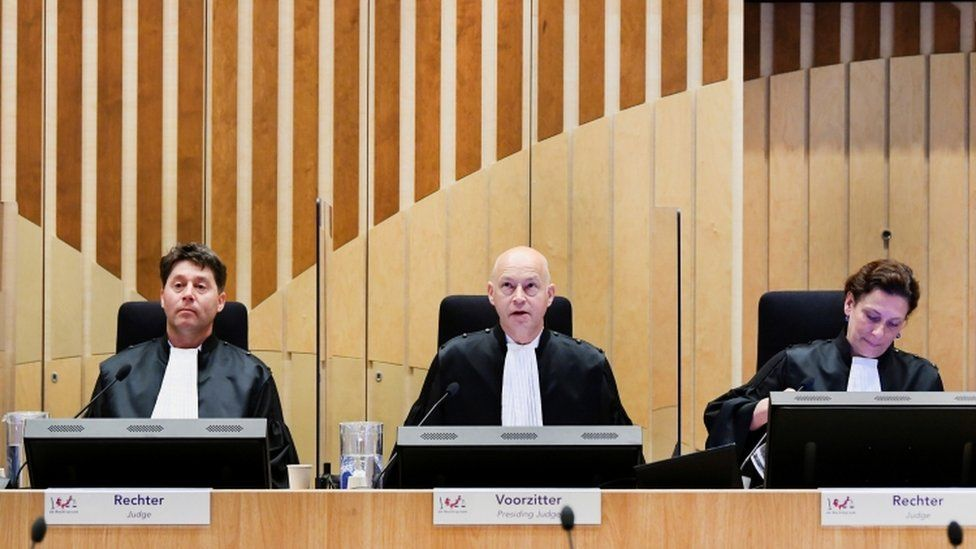 The trial is taking place in a high-security court near Schiphol airport
