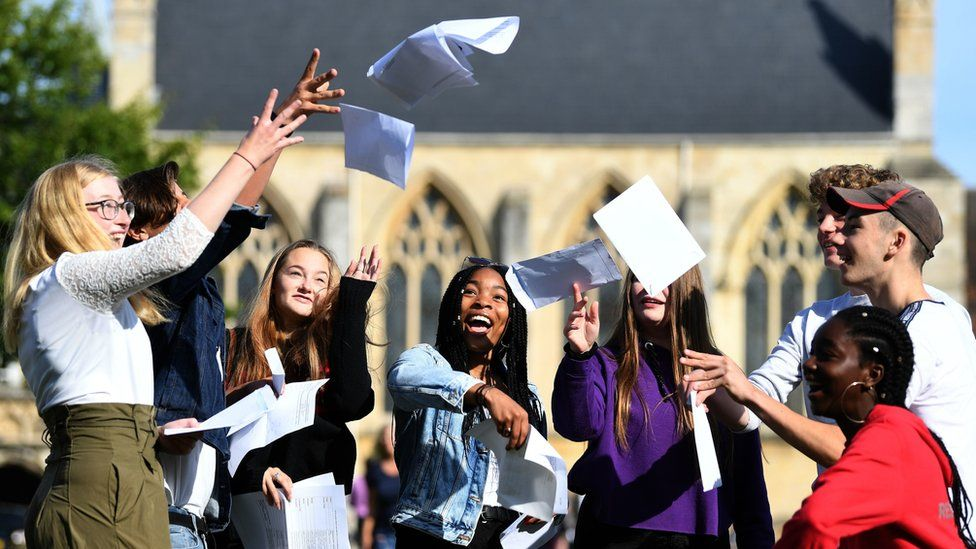 Somto Elumogo (centre) and other students celebrate with their GCSE results at Norwich School in Norwich, Norfolk